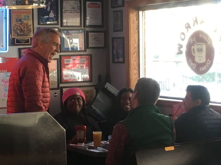 Former Republican congressman and now presidential candidate Joe Walsh (left) greets customers at the Red Arrow Diner in Manc