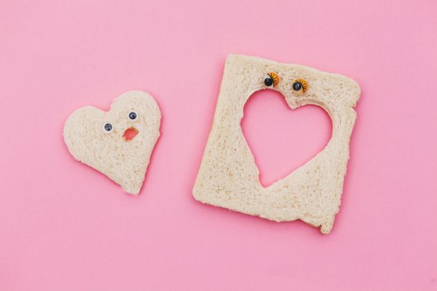 heart shape piece of bread couple in pink
