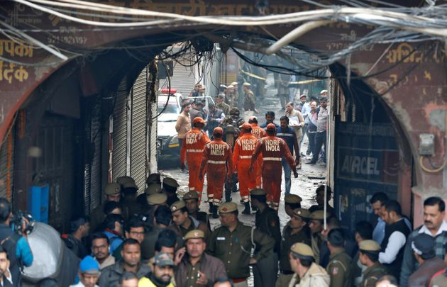 Members of India's National Disaster Response Force (NDRF) head towards the site of the