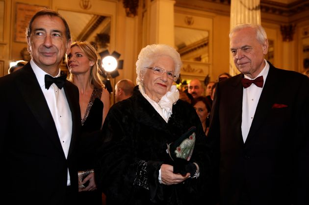 Holocaust survivor Liliana Segre stands between La Scala general manager Alexander Pereira, right, and...