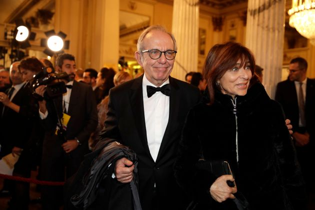 Pier Carlo Padoan is flanked by his wife Maria Grazia arrive for the gala premiere of La Scala opera...