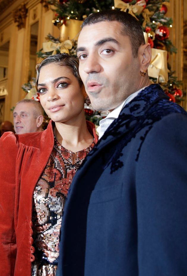 Rapper Marracash is flanked by his partner singer Elodie as they arrive for the gala premiere of La Scala...
