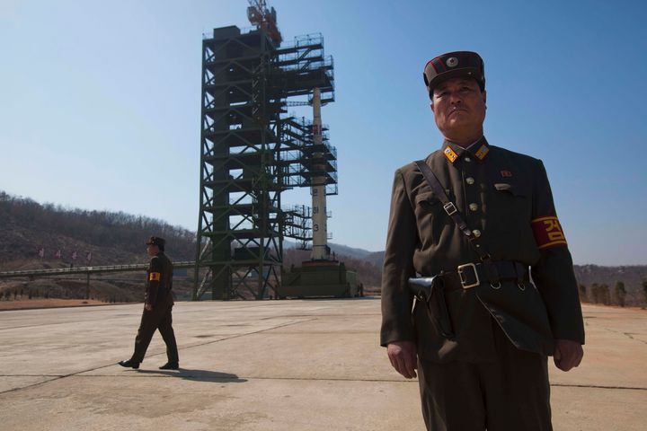 In this file photo, North Korean soldiers stand in front of the country's Unha-3 rocket at Sohae Satellite Station in Tongcha