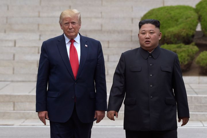 FILE - In this June 30, 2019, file photo, President Donald Trump, left, meets with North Korean leader Kim Jong Un at the Nor