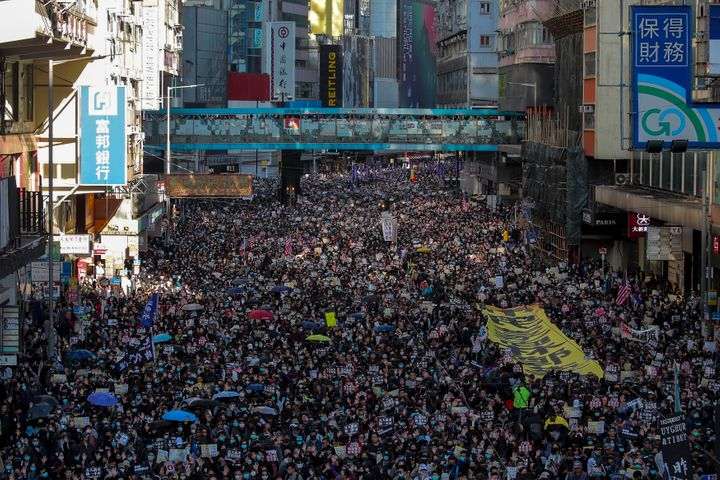 Pro-democracy protesters march on a street during a protest in Hong Kong, Sunday, Dec. 8, 2019. (AP Photo/Kin Cheung)