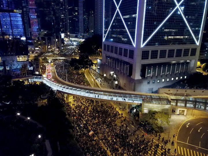 Pro-democracy protesters march into the night in Hong Kong, Sunday, Dec. 8, 2019. (AP Photo/Dake Kang)