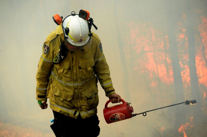 A NSW Rural Firefighter establishes a backburn during bushfires in Mangrove Mountain, New South Wales, Australia, December 8, 2019. AAP Image/Jeremy Piper/via REUTERS