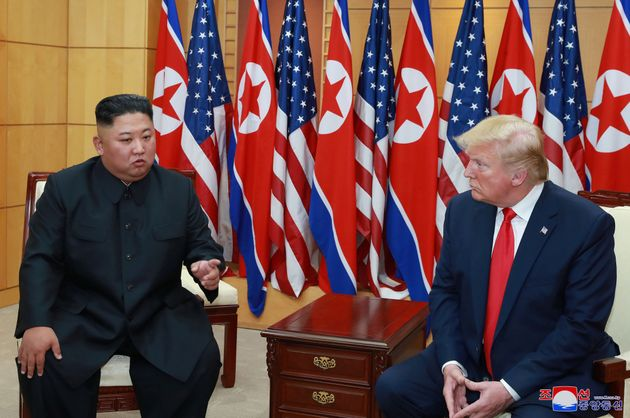 U.S. President Donald Trump speaks with North Korean leader Kim Jong Un during a meeting at the demilitarized...