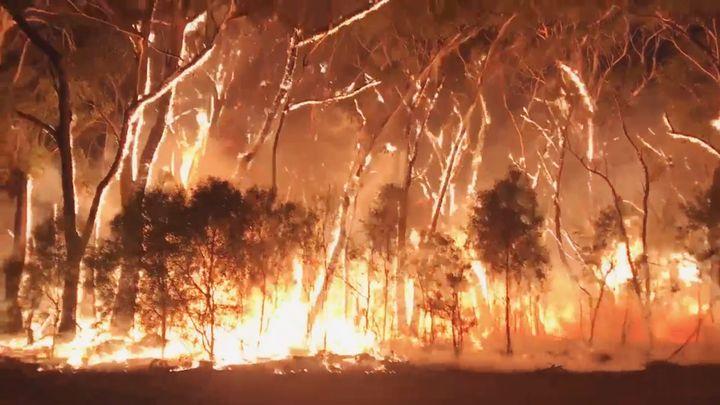 A fire blazes across bush in Newnes Plateau, New South Wales, Australia.