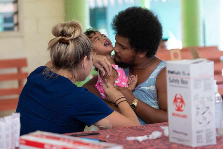 Hawaii aid workers nurses help out with MMR vaccinations on December 6, 2019 in Apia, Samoa.