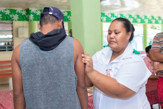 A nurse administers MMR vaccine based on orders on December 6, 2019 in Apia,