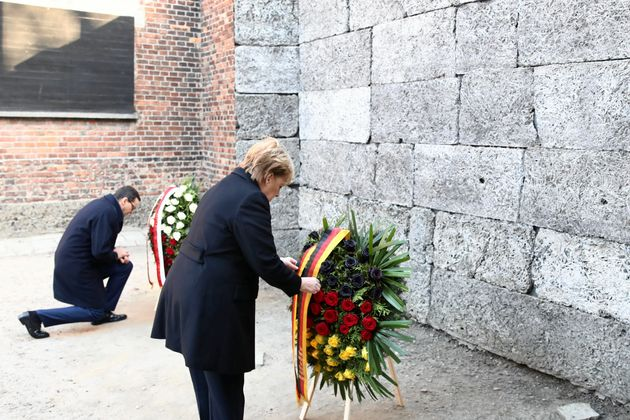 Polish Prime Minister Mateusz Morawiecki and German Chancellor Angela Merkel attend a wreath-laying ceremony...