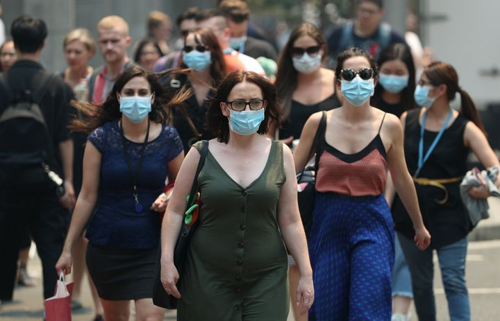 People are seen wearing face masks to protect from smoke haze in Sydney.