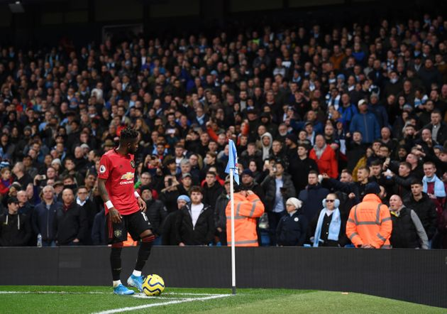 MANCHESTER, ENGLAND - DECEMBER 07: Fred of Manchester United looks to the crowd as missiles are thrown...