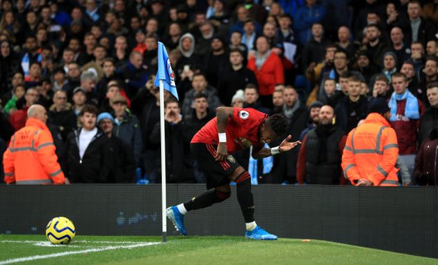 Manchester United's Fred reacts after objects are thrown at him during the Premier League match at the...