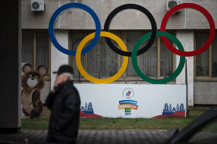 Olympic Rings and a model of Misha the Bear Cub, the mascot of the Moscow 1980 Olympic Games, left, are seen in the yard of Russian Olympic Committee building in Moscow, Russia