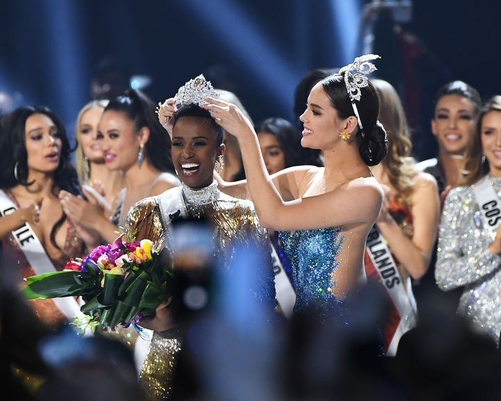 Miss Universe 2019 Zozibini Tunzi, of South Africa, is crowned onstage by Miss Universe 2018 Catriona Gray at the 2019 Miss U