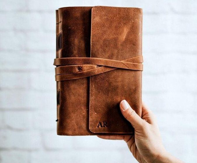"""<a href=""""https://fave.co/2Pqy6wV"""" target=""""_blank"""" rel=""""noopener noreferrer"""">Personalised Leather-Bound Diary, Etsy,</a> &pound;33.63"""