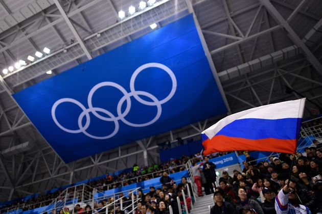 A Russian flag is waved during a hockey game in Gangneung, South Korean, during the Pyeongchang 2018...