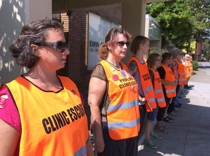 Escort volunteers line up outside the EMW Women's Surgical Center in Louisville, Kentucky, in 2017. The clinic is the state's
