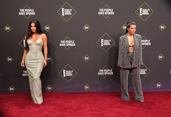 Kim and Kourtney Kardashian posted at the Peoples Choice Awards on Nov. 10.