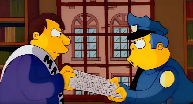 Mayor Quimby and Chief Wiggum fight over the