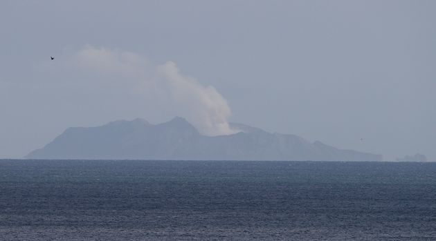 A plume of steam is seen above White Island early morning off the coast of Whakatane, New Zealand, Tuesday,...
