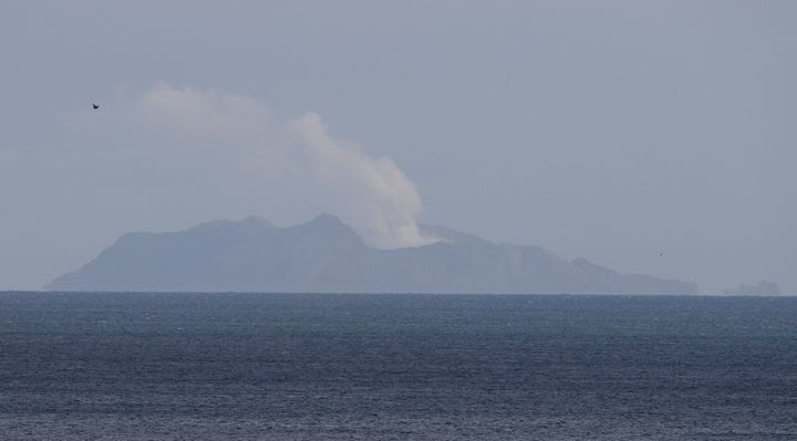 A plume of steam is seen above White Island early morning off the coast of Whakatane, New Zealand, Tuesday, Dec. 10, 2019.