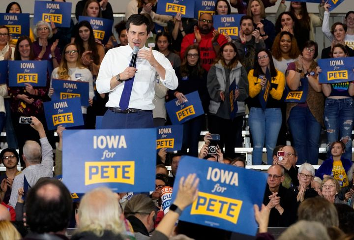 Pete Buttigieg speaks to voters in Coralville, Iowa, on Sunday. Reporters and rivals have challenged him to reveal more infor
