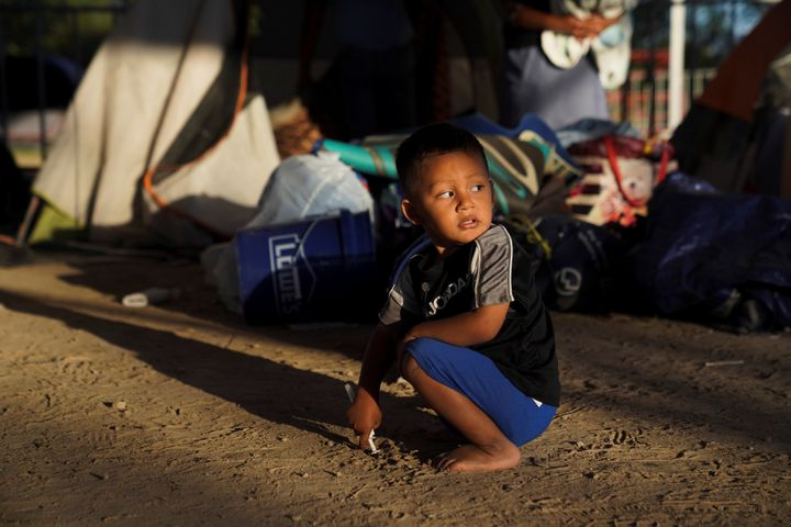 Honduran asylum-seeker Elias, 2, plays near the tent where he now lives in Matamoros, Mexico, on Dec. 7, 2019.