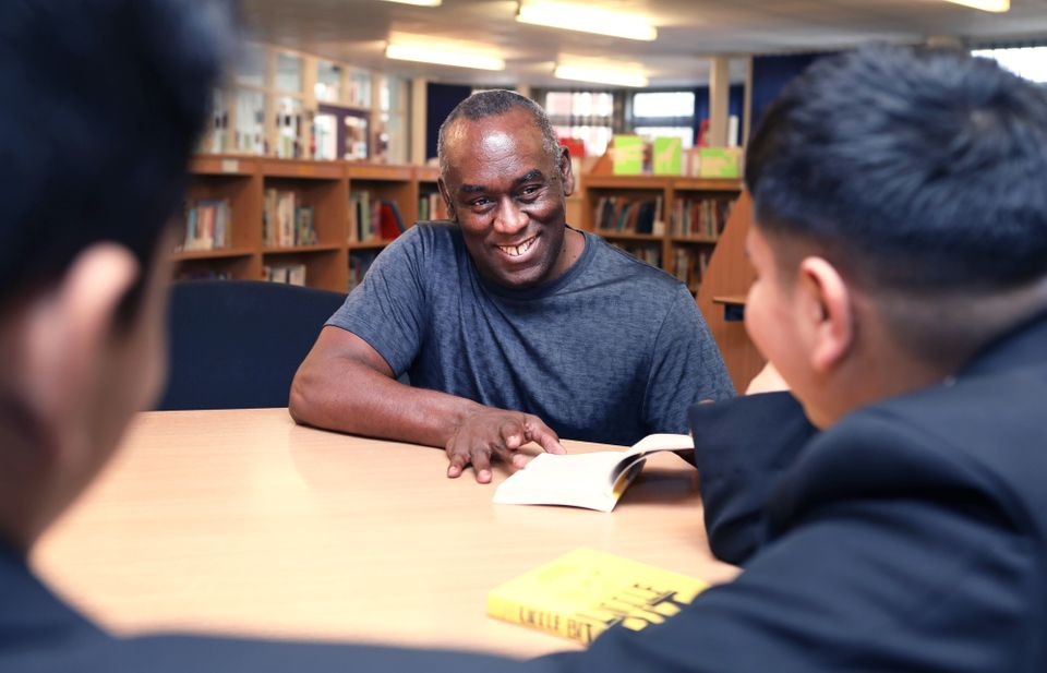Pupils at Yardleys School in Birmingham meet author Alex Wheatle at a BookTrust event to highlight books...
