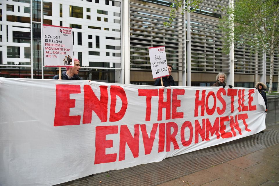 Demonstrators protest against the hostile environment immigration policy outside the Home Office in Westminster,...