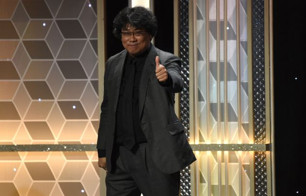 Joon Ho gestures as he appears on stage to accept the Hollywood filmmaker award for