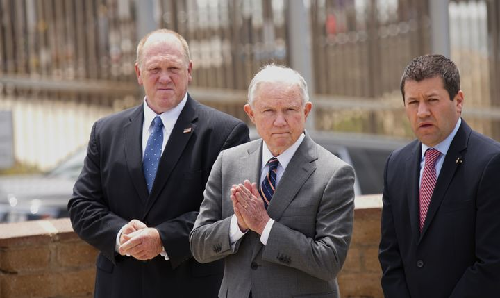 Then-Attorney General Jeff Sessions and Thomas Homan, left, then head of Immigration and Customs Enforcement, hold a news con