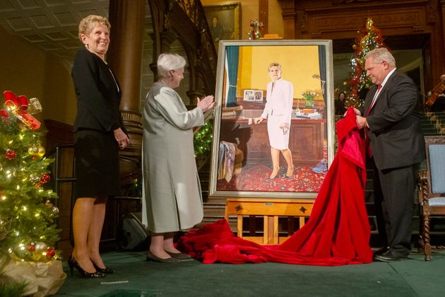 Kathleen Wynne looks to family members as her portrait, painted by Linda Dobbs, is unveiled by Doug Ford...