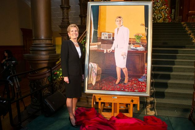 Wynne stands beside her portrait, painted by Linda Dobbs, after its unveiling ceremony at the Ontario...