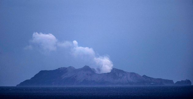 WHAKATANE, NEW ZEALAND - DECEMBER 10: Smoke and ash rises from a volcano on White Island early in the...