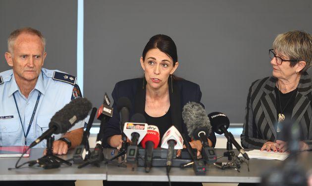 WHAKATANE, NEW ZEALAND - DECEMBER 10: (L-R) Police Sup Bruce Bird, New Zealand PM Jacinda Ardern and...