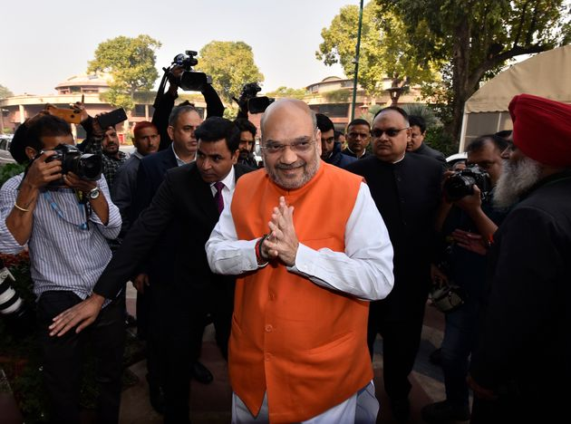 Union Home Minister Amit Shah arrives to attend the ongoing winter session of Parliament on December...