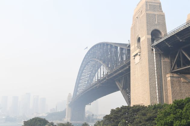 SYDNEY, AUSTRALIA - DECEMBER 10: Smoke haze is seen over the Sydney Harbour Bridge on December 10, 2019...