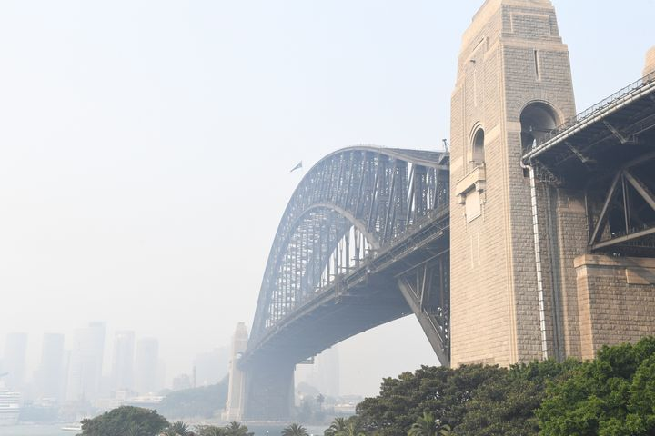 SYDNEY, AUSTRALIA - DECEMBER 10: Smoke haze is seen over the Sydney Harbour Bridge on December 10, 2019 in Sydney, Australia. Smoke haze hangs over the city as the New South Wales fire danger risk is raised from 'very high' to 'severe'. (Photo by James D. Morgan/Getty Images)
