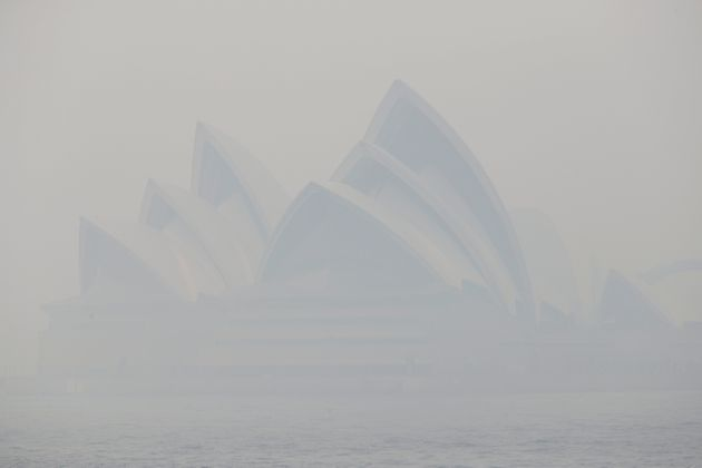 Thick smoke from wildfires shroud the Opera House in Sydney, Australia, Tuesday, Dec. 10, 2019. Hot dry...