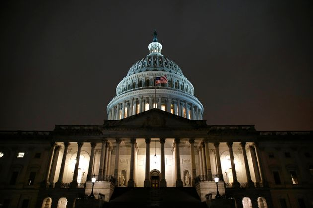Lights shine on the U.S. Capitol dome, Monday, Dec. 9, 2019, after the House Judiciary Committee heard...