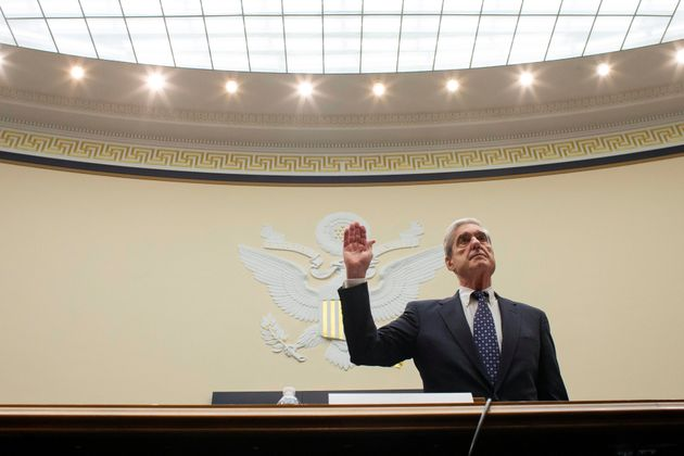Former special counsel Robert Mueller is sworn in to testify before the House Judiciary Committee hearing...