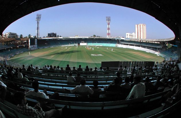 A few spectators watch England field against a Mumbai Cricket Association President's XI at the Wankhede...