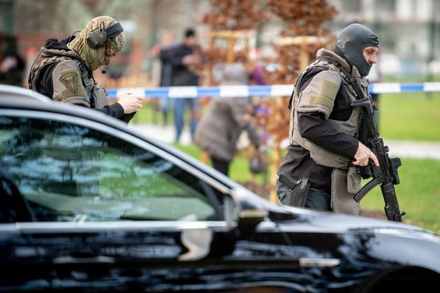 Police officers are seen near the site of the