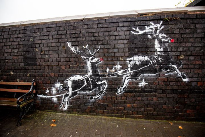 The Banksy mural in Birmingham shows two painted reindeer appearing to pull along a real bench.