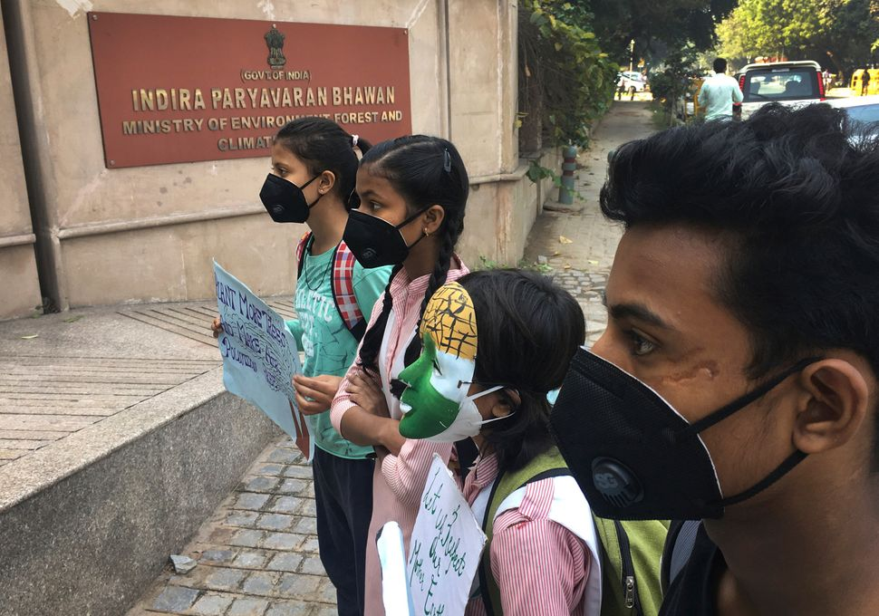Schoolchildren protest outside the Indian Environment Ministry against alarming levels of pollution in New Delhi on Nov. 5, 2