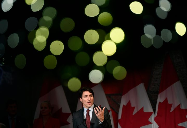 Christmas lights on a wreath glow above Prime Minister Justin Trudeau as he speaks to supporters at the Laurier Club holiday reception, an annual donor event held by the Liberal Party of Canada, in Ottawa on Dec. 9, 2019.