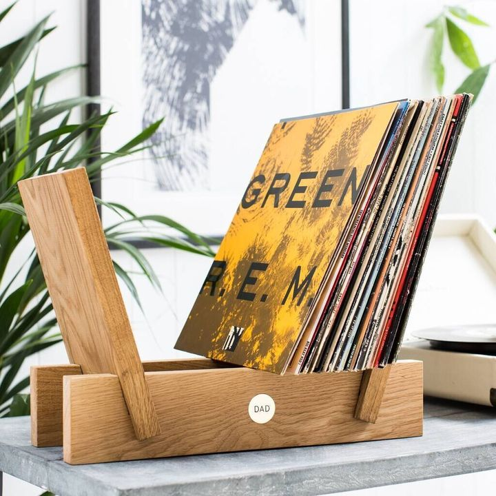 """<a href=""""https://fave.co/34bloY1"""" target=""""_blank"""" rel=""""noopener noreferrer"""">Personalised Oak And Brass Vinyl Storage Rack, Not On The High Street, </a>&pound;49"""